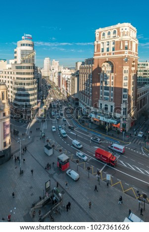 Madrid, Spain - January 15, 2018 : Morning aerial view of Plaza de Callao. Edificio Carrion and Palacio de la Prensa Building. Gran via  street Junction with Plaza de Espana in the Back