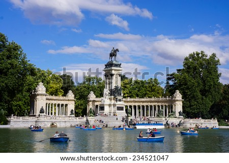 MADRID, SPAIN - JULY 17, 2013. Parque do Retiro (Retiro Park), Monumento a Alfonso XII (Monument to King Alfonso XII), with people on small boats.
