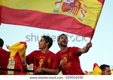 MADRID, SPAIN  JULY 7: Sergio Ramos and Jesus Navas celebrate the Spanish national team winning the 2012 Eurocup. On July 7, 2012 at the Cibeles. - stock photo