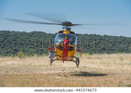 MADRID, SPAIN - JUNE 23, 2016: A Spanish Army Eurocopter EC-135 emergencies helicopter taking off from an open field site (part of 50th anniversary of the unit).