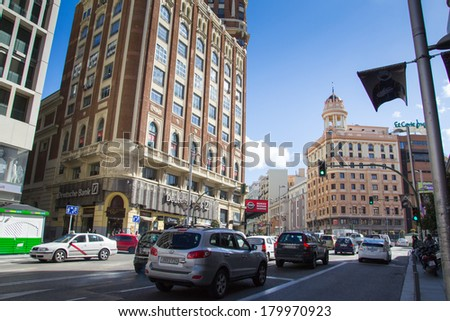 MADRID, SPAIN - MAR 4, 2014: Building on Gran Via (Great Way), Madrid, Spain. Gran via is known as the the street that never sleeps or as Spanish Brodway