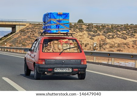 MADRID SPAIN, 22 MARCH 2013 ,Car loaded with packages circulating during the holidays on the highway, 22 Mar 2013, Madrid Spain - stock photo