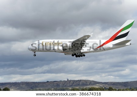 MADRID, SPAIN - MARCH 05th 2016: Aircraft -Airbus A380-861-, of -Emirates- airline, is landing on Madrid-Barajas -Adolfo Suarez- airport, on March 05th 2016.It's the world's largest passenger airliner - stock photo