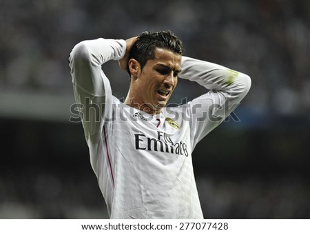 MADRID, SPAIN - March 10th, 2015 :  Portuguese CRISTIANO RONALDO of REAL MADRID dejected after missing a goal during Europe Champions League match vs SHALKE 04 at Santiago Bernabeu Stadium.  - stock photo