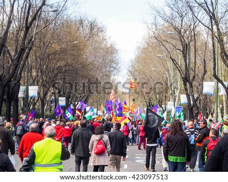 Madrid, Spain - 22 March 2014: Unidentified people protests on anti-austerity on the street in, Madrid, Spain