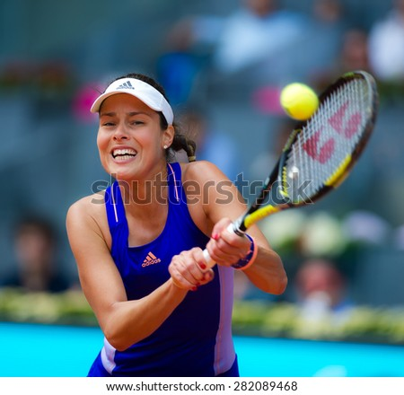 MADRID, SPAIN - MAY 2 :  Ana Ivanovic in action at the 2015 Mutua Madrid Open WTA Premier Mandatory tennis tournament - stock photo