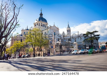 Madrid, Spain - May 6, 2012: Cathedral Almudena with tourists on a spring day in Madrid, Spain - stock photo