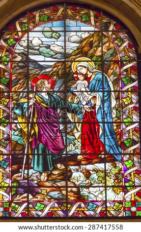 MADRID, SPAIN - MAY 17, 2014 Mary Joseph Baby Jesus Stained Glass San Francisco el Grande Royal Basilica Madrid Spain. Basilica designed in the second half of 1700s, completed by Francisco Sabatini. - stock photo