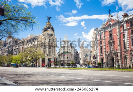 Madrid, Spain - May 6, 2012: Metropolis Building (Edificio Metropolis) and Grassy Building (Edificio Grassy) famous Beaux-Arts style of Madrid and San Jose church, Spain - stock photo