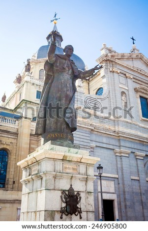 Madrid, Spain - May 6, 2012: Pope John Paul II statue in front of Cathedral Almudena on a spring day in Madrid, Spain