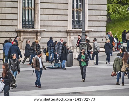 MADRID, SPAIN - MAY 15: Royal Palace surroundings on May 15, 2012 in Madrid, Spain. Diversity of people. Tourist scene. Tourism represents 9% of Spain global income. 53 million tourist in 2010.