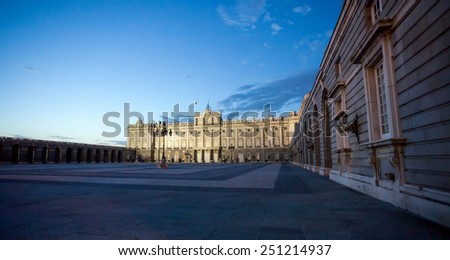 Madrid, Spain - May 6, 2012: Royal palace with tourists illuminated on spring night in Madrid, Spain