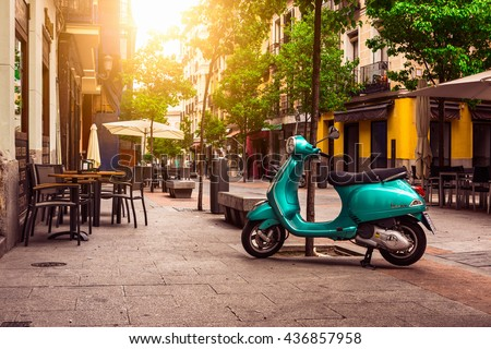 Madrid, Spain - May 10, 2016: Scooter Vespa parked on old street in Madrid, Spain - stock photo