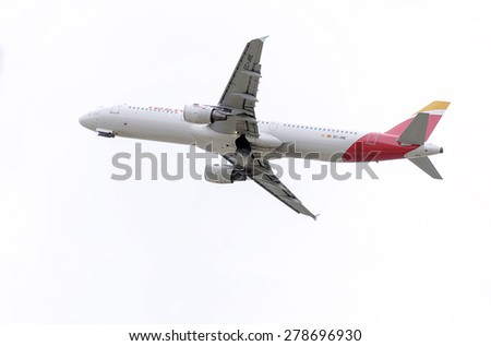 MADRID, SPAIN - MAY 3th 2015: Aircraft -Airbus A321-, of -Iberia- airline, is taking off from Madrid-Barajas -Adolfo Suarez- airport, on May 3th 2015. - stock photo