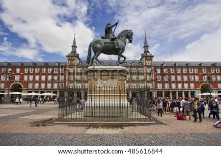 Madrid, Spain - May 29, 2016: Tourists near the bronze statue of King Philip III at the center of the square, created in 1616 by Jean Boulogne and Pietro Tacca. in Madrid, Spain on May 29, 2016