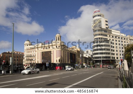Madrid, Spain - May 29, 2016: Traffic of cars and people walking past the magnificent architecture of the Gran Via main street of Madrid, Spain on May 29, 2016