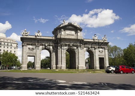 Madrid, Spain - May 29, 2016: Traffic of cars drive past Puerta de Alcala triumphal arch in Madrid, Spain on May 29, 2016