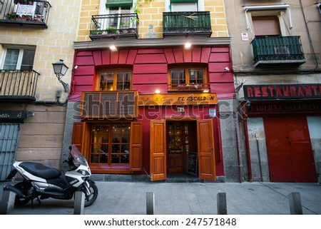 Madrid, Spain - May 6, 2012: Typical restaurant on a street of Madrid city, Spain - stock photo