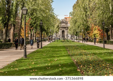 MADRID, SPAIN - NOVEMBER 20, 2013: Buen Retiro Park (Park of Pleasant Retreat) - one of largest parks in Madrid. Park belonged to Spanish Monarchy until late 19th century when it became a public park. - stock photo