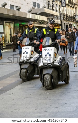 Madrid, Spain - November 27, 2015: Police patrol Madrid with his new electric motorcycle, do not pollute not make noise and are very well received by people. - stock photo