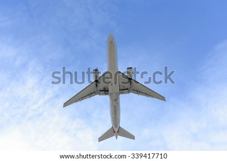MADRID, SPAIN - NOVEMBER 14th 2015: Bottom view of an aircraft, of an unrecognized commercial airline, after it has taking off from Madrid-Barajas -Adolfo Suarez- airport, on November 14th 2015.
