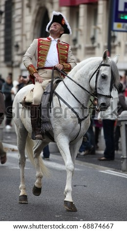"MADRID, SPAIN - OCT 31: Unidentified horseman as part of the festival ""Fiesta de la Trashumancia"" rides on Oct 31, 2010 on the street Gran Via in Madrid, Spain."