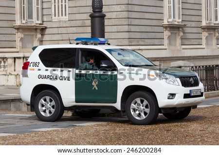 MADRID, SPAIN - OCTOBER 10: Guardia Civil guarding the Royal Palace on October 10, 2014 in Madrid, Spain. The Guardia Civil is a military force charged with police duties in Spain. - stock photo