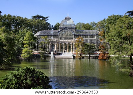 MADRID, SPAIN - OCTOBER 08, 2013: Pond and Crystal Pavilion in the Retiro Park in the style of early modernism, Madrid - stock photo