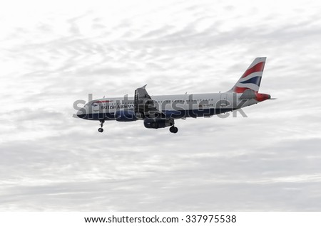 MADRID, SPAIN - OCTOBER 24th 2015: Aircraft -Airbus A320-232-, of -British Airways- airline, is landing on Madrid-Barajas -Adolfo Suarez- airport, on October 24th 2015. Cloudy day. It's getting dark. - stock photo