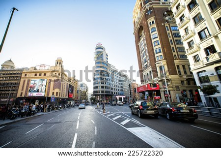 MADRID, SPAIN - OCTOBER 18: View Gran Via with the Capitol Building, one of the main streets and most famous landmarks of the city, on october 18, 2014 in Madrid, Spain