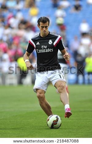 MADRID, SPAIN - September 13th, 2014 :  GARETH BALE of REAL MADRID warms up during La Liga match at Santiago Bernabeu Stadium.  - stock photo