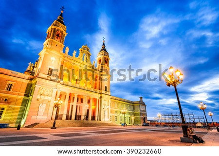 Madrid, Spain. Twilight skyline of Santa Maria la Real de La Almudena Cathedral, seat of the Roman Catholic Archdiocese of Madrid - stock photo