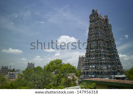 MADURAI, INDIA - AUG 22: Meenakshi Temple - one of the biggest and oldest temple on August 22, 2012 in Madurai, India. Its about 2500 years old. - stock photo