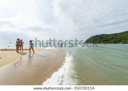 MAE HAAD BEACH, THAILAND, 3 JANUARY 2015 - Tourits enjoying the sun
