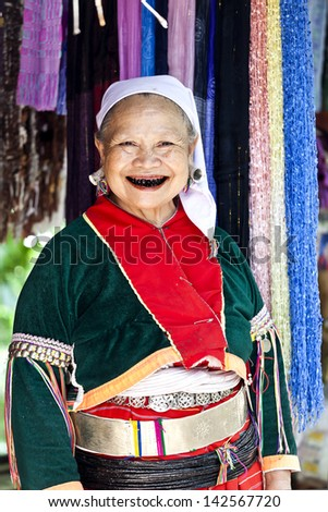 MAE HONG SON - JULY 11: Lahu old woman with black teeth because of chewing herbs. The Lahu tribes are a minority of Thailand surviving with opium cultivation. Mae Hong Son, Thailand on July 11, 2012. - stock photo