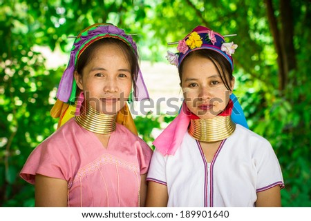 Mae Hong Son, Thailand - July 22, 2013: Karen tribe women from the Padaung tribe poses for the camera in Mae Hong Son on July 22, 2013. Karen people wear rings on their neck from as young as five. - stock photo