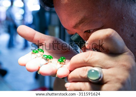MAE SOT THAILAND - AUGUST31 : Merchants gem stones market selecting and appraisal price wrap of ruby the broker stones present at Mae Sot province, Tak, Thailand on AUGUST31, 2015