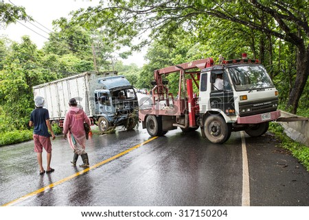 MAE SOT THAILAND - JULY29 : Crane is pulling a truck accident outside main road  at  Mae Sot, Tak, Thailand on JULY29, 2015 Accident statistics are higher due to the expansion of trade through region.