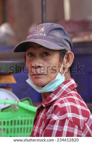 MAE SOT, THAILAND - SEPTEMBER 1: The garbage collector at the fresh food market of Mae Sot, Thailand on the 1st September, 2014.