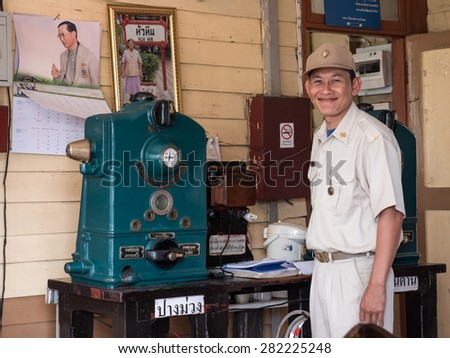 MAE TAN NOI, THAILAND - MARCH 22 2015: Officers poses for a portrait at remote train station Mae Tan Noi in Northern Thailand. - stock photo