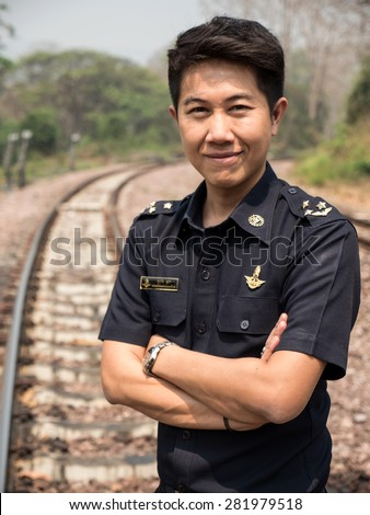 MAE TAN NOI, THAILAND - MARCH 22 2015: Tain Master in natural train station Mae Tan Noi on one of the hottest recorded days in Northern Thailand. - stock photo