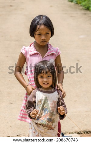 MAEHONGSON THAILAND-July 26:Unidentified Children playing outside during KAREN village meeting on July 26, 2014 in PAI, MAEHONGSON,  Thailand. PAI is a city of ethnic, well known as tourist place.