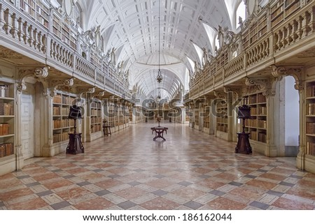 Mafra, Portugal - September 02, 2013: Library of the Mafra National Palace. Franciscan religious order. 18th Century Baroque architecture. - stock photo