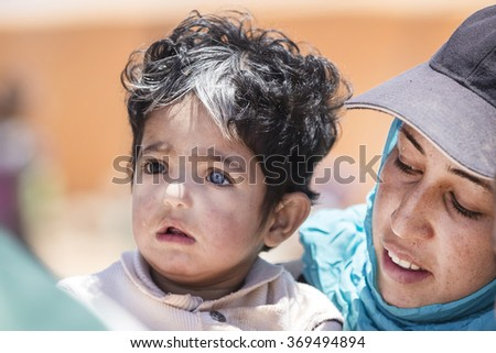 Mafraq, Jordan, 2015 June 14, Zaatari refugee camp in the Syrian mother and daughter