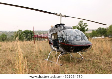MAGALIESBERG, SOUTH AFRICA - October 14: Dehorning of rhinos in Askari Game Lodge for protection on October 14, 2015 in Magaliesberg, South Africa. Helicopter used to dart animals from air.