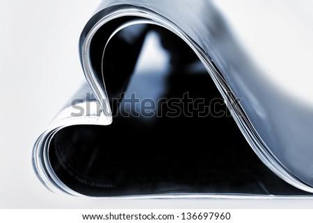 Magazine in heart shape on black - stock photo