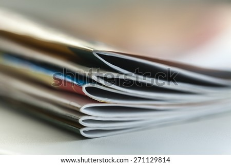 Magazine. Magazines with selective focus on foreground edge - stock photo
