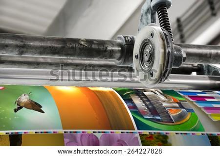 Magazine offset printing machine close up - stock photo