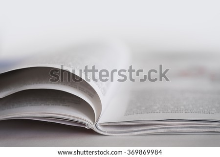Magazine on a table with shallow depth of field - stock photo