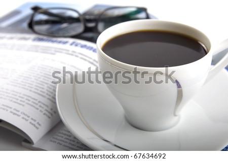 Magazine reading during coffee break - stock photo